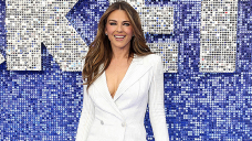 Elizabeth Hurley, 55, Sizzles In Beaded Blue Bikini After Carrying Nothing Underneath Fur Coat