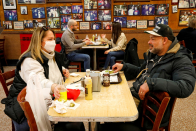Virologist says reopening indoor dining is 'reckless' as fresh, more transmissible coronavirus strains spread in the U.S.