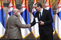 Serbian President Aleksandar Vučić presents Michael Freund with award