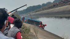 Bus drives off bridge into canal in central India; 40 dead