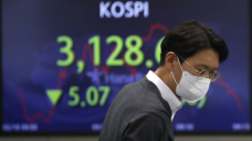 Asian shares mostly lower after mixed day on Wall Dual carriageway