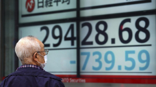 Asian shares sink, Tokyo down 4% after tech rout on Wall St