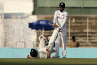 India's Virat Kohli wins hearts of cricket fans rushing to help England's Joe Root