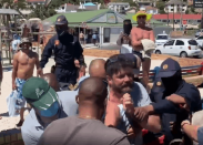 CPT man accused of 'assaulting journo' throws anti-conceal tantrum in court