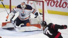 Smith records 27 saves in season debut, Oilers top Sens 3-1