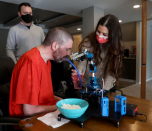 When this Michigan man with ALS couldn't feed himself anymore, he built his own feeding robot
