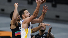 Curry leads Warriors to 114-91 victory, ending Spurs' streak