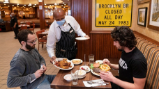 'All we're doing right now is purely to stay alive': Indoor dining has its risks, but can its return save NYC restaurants?