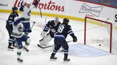 Demko gets first shutout as Canucks beat Jets 4-0