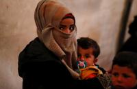 Biden calls off Syria strike after lady, children seen at site