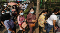 The Latest: China has administered 65M vaccine doses at home