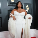 Lizzo apologises for B-discover creep-up at Grammys