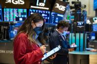 Nasdaq jumps as Apple gains, S&P 500 inches higher