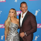 Jennifer Lopez and Alex Rodriguez put split rumours to bed with passionate PDA