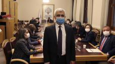 Turkish police detain politician staging parliament sit down-in