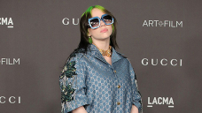 Billie Eilish Rocks $470 Gucci Bucket Hat & Outsized Polo Shirt After Debuting New Blonde Hair