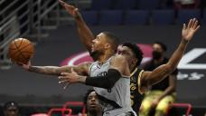 McCollum, Lillard lead Blazers past Raptors 122-117