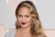 Chrissy Teigen shows off new silver hair in 'midlife crisis' transformation