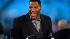 Michael Strahan appeared to fix the gap in his teeth precariously close to April Fools' Day