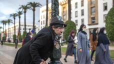 AP PHOTOS: Moroccan mimics Charlie Chaplin to mask hardships