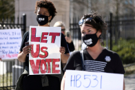 U.S. companies face boycott threats, mounting pressure to take sides in The usa's voting rights battle
