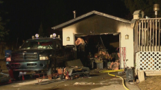Man in life-threatening condition after Calgary garage fire