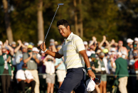 The Masters: Hideki Matsuyama survives late mistakes to win first males's major for Japan