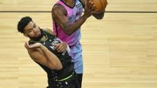 Cities scores 24, helps Timberwolves beat Heat 119-111