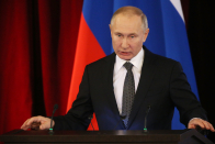 Putin warns against crossing Russia's 'red strains,' talks up military advancement