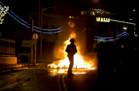 Dozens hurt and arrested as Jewish and Arab extremists clash in Jerusalem