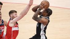 Spurs outlast Wizards in OT, end Washington's streak at 8