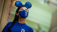 Disney fans celebrate the reopening of Disneyland with custom Mickey ears and masks