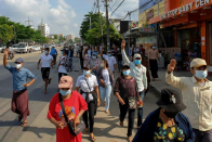 Bomb blasts, flash protests as Myanmar enters fourth month under junta