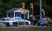 FBI agent opened fire on an armed man outside CIA headquarters in Virginia