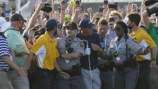 Koepka says injured knee hurt by rushing fans at PGA