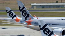 Jetstar to hand out hundreds of dollars in flight vouchers at train stations