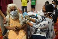 Canadians cheer as vaccination rates climb, but global health advocates ask: At what designate?
