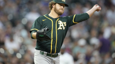 Olson, Pinder homer, lead Irvin, A's over Rockies 6-3
