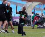 Top baby-kisser's plea to Kaizer Chiefs: 'Care for Arthur Zwane as head coach'