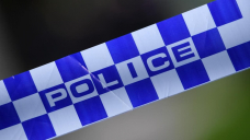 Man shot dead at front door in Canberra