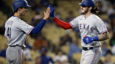 Rangers snap 16-game road losing tear, rout Dodgers 12-1