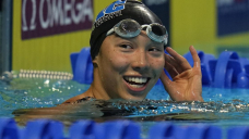 Original giant title: Huske claims spot on Olympic swim team in 100 fly