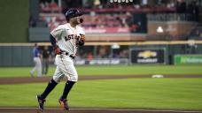 Altuve slugs way into MLB history as Astros down Rangers 8-4
