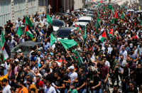 Palestinian mourners call for change at funeral of Abbas critic
