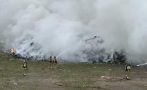 Crews battle 'football field'-sized fire at landfill near London, Ont.