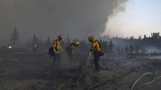 California firefighters battle big wildfires in high heat