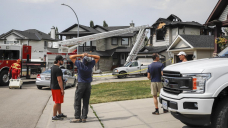 Community mourns 'colossal household' after seven people — including four children — die in house fire east of Calgary