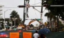 Miami condo give scheme: rescue effort threatened as tropical storm nears