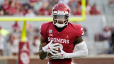 Oklahoma dismisses running back Mikey Henderson after connection to alleged armed robbery