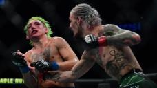 Sean O'Malley def. Kris Moutinho at UFC 264: Most involving photos